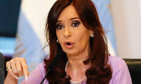 Argentina's President Cristina Fernandez de Kirchner gestures as she makes an announcement on new subsidies and benefits for school renovation works, at the Casa Rosada government house in Buenos Aires